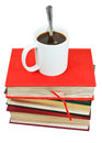 Mug of coffee on stack of books isolated white background Stock Photos
