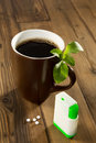 Mug of coffee with stevia tablets as natural and healthy sweetener Stock Photo