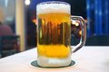 Mug of cold beer from the frost Stock Images