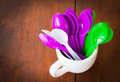 Mug and colorful spoons or background Stock Photography