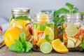 Mug delicious refreshing drink of mix fruits with mint on wooden infused water Stock Photography