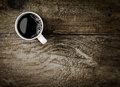 Mug of espresso coffee on rustic wood overhead view a freshly brewed wooden background with woodgrain texture and cracks with Stock Photography