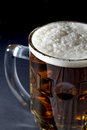 Mug of Fresh Beer with Foam Over Black Background Royalty Free Stock Photo