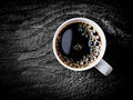 Mug of fresh full roast filter coffee close up view a white or espresso with frothy bubbles on a grungy weathered wooden Royalty Free Stock Photography