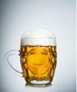 Mug full of fresh beer  on white Royalty Free Stock Photo