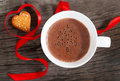 Mug of hot chocolate or cocoa with cookies decorated by red ribbon Stock Photography
