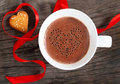 Mug of hot chocolate or cocoa with cookies decorated by red ribbon Stock Images