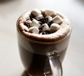 Mug of hot chocolate with marshmallows on table Stock Photo