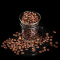 Mug made of glass with whole coffee beans Royalty Free Stock Photography