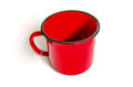 Mug painted in red close up view of a Royalty Free Stock Photo