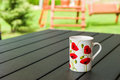 Mug on a table porcelain in the garden Royalty Free Stock Photography