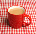 Mug of tea hot on a red checked tablecloth Stock Photography