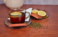 Mug of tea with lemon and cinnamon stick a cup a fragrant a slice on a wooden table Stock Photo