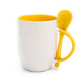 Mug with yelllow spoon Stock Photo