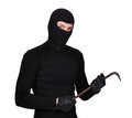 Mugger in mask with nail puller Royalty Free Stock Photo