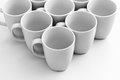 Mugs on white beautiful group of over glossy surface Royalty Free Stock Photos