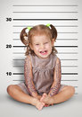 Mugshot of funny naughty baby with tattoo disobedient child con concept Royalty Free Stock Photo