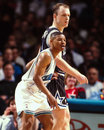 Mugsy bogues against scott skiles hornets point guard posts up magic guard image taken from color negative Stock Image