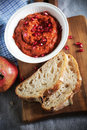Muhammara red bell pepper dip like ajvar relish roasted from middle east or the ballkans with pomegranate apple and bread slices Stock Image