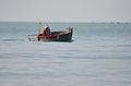 Vietnamese fisher fishing in Mui Ne, Vietnam Royalty Free Stock Photo