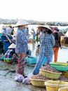 Mui ne vietnam febr mui ne is a popular tourist attraction in vietnam a lot of fishers sort out their catch on the shore and sell Royalty Free Stock Images