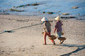 Mui ne vietnam february unidentified women walk along the sea to help their relatives fishers sort out fish take february in mui Stock Photo