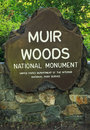 Muir woods national monument sign this marks the entrance to historic named after american conservationist john which Royalty Free Stock Image