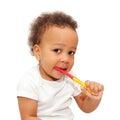 Mulatto black baby brushing teeth.