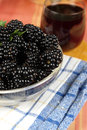 Mulberries on table with a juice ripe Stock Photography