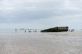 Mulberry harbour remains of harbor on the gold beach in normandy arromanches france Royalty Free Stock Image