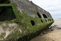 Mulberry harbour remains of harbor on the gold beach in normandy arromanches france Royalty Free Stock Photo