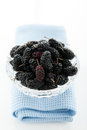 Mulberry hill ripe mulberries in a crystal vase on a white background Royalty Free Stock Photo