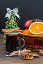 Mulled wine, Christmas tree and a basket of fruit close-up on a black background Royalty Free Stock Photo