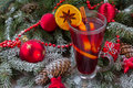 Mulled wine with christmas tree close up decorated in snow Stock Photography