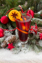 Mulled wine with christmas tree in snow Stock Photos