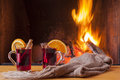 Mulled wine at cozy fireplace firelight only steaming hot Royalty Free Stock Image