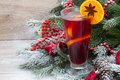 Mulled wine with decorated christmas tree in snow Stock Image