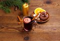 Mulled wine in glass with cinnamon stick candle and sweets horizontal Stock Photos