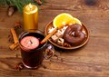 Mulled wine in glass with cinnamon stick and sweets candle top view Royalty Free Stock Photo