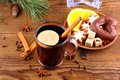 Mulled wine in glass with cinnamon stick and sweets top view Royalty Free Stock Image