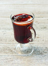Mulled wine in glass over wood background Royalty Free Stock Images