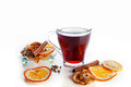 Mulled wine in a glass with spices ginger cinnamon and fruit on a white background lemon Royalty Free Stock Photo
