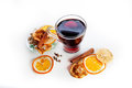Mulled wine in a glass with spices ginger cinnamon and fruit on a white background lemon Royalty Free Stock Images