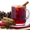 Mulled wine hot winter drink in glass with spices on white background Royalty Free Stock Photo