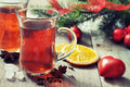 Mulled wine with spices and christmas decoration on wooden background Royalty Free Stock Photography