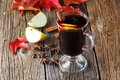 Mulled wine and spices on weathered wooden table Royalty Free Stock Photo