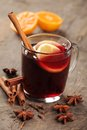 Mulled wine and spices on wooden background Royalty Free Stock Photo