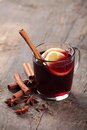Mulled wine and spices on wooden background selective focus Stock Image
