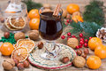 Mulled wine winter hot drink with cinnamon dried orange slices tangerine and walnut Royalty Free Stock Photo