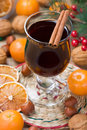 Mulled wine winter hot drink with cinnamon dried orange slices tangerine and walnut Stock Photography